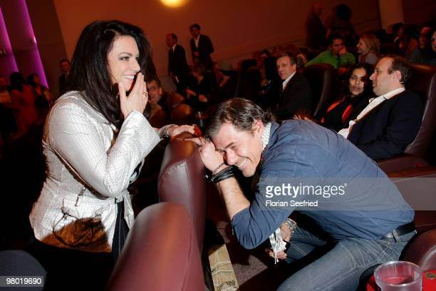 Actress Christine Neubauer and actor Sven Martinek make fun while attending the premiere of 'Haltet Die Welt an' at cinema Astor Film Lounge on March...
