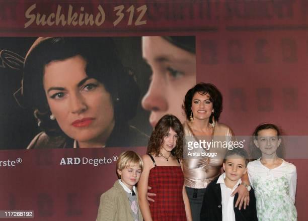 Actress Christine Neubauer and the children Cedric Eich Janina Fautz Jannis Michel and Jennifer attend the Suchkind 312 premiere at MercedesWelt at...