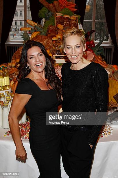 Actress Christine Neubauer and TV moderator Baerbel Schaefer pose during a photocall at the Weight Watchers round table press conference on January...