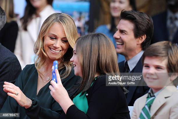 Actress Christine Taylor and her children Ella Stiller and Quinlin Stiller, and Actor Tom Cruise watch as actor Ben Stiller is honored with hand and...
