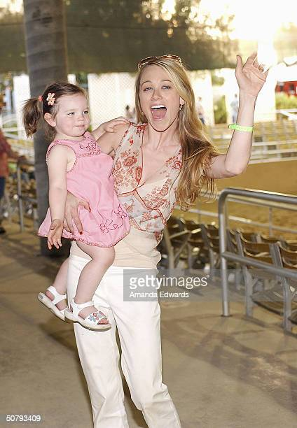 Actress Christine Taylor and her daughter Ella attend the 14th Annual Hollywood Charity Horse Show on May 1 2004 at the Los Angeles Equestrian Center...