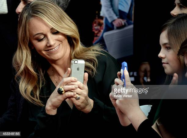 Actress Christine Taylor and her daughter Ella Stiller watch as actor Ben Stiller is honored with a hand and footprint ceremony at the TCL Chinese...