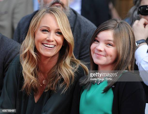 Actress Christine Taylor and her daughter Ella Stiller watch as actor Ben Stiller is honored with hand and footprint ceremony at TCL Chinese Theatre...