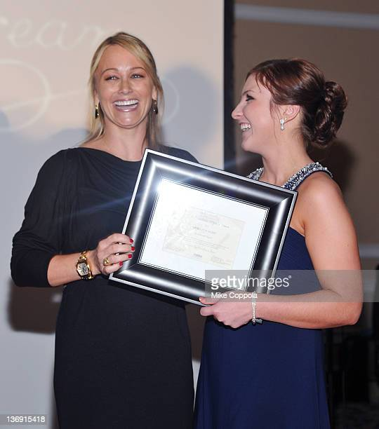 Actress Christine Taylor receives the Hero for Hope award from Jacqueline Judson at the 2012 A Midwinter Night's Dream Gala at Oheka Castle on...