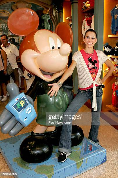 Actress Christy Carlson Romano poses with a 75th Anniversary Mickey Mouse designed by Carlson Romano depicting her alter ego Kim Possible as she...
