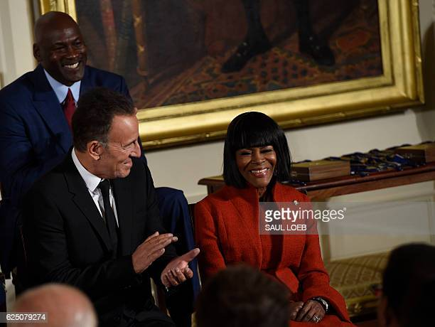 Actress Cicely Tyson smiles next to Bruce Springsteen and Michael Jordon before US President Barack Obama presents the Presidential Medal of Freedom...