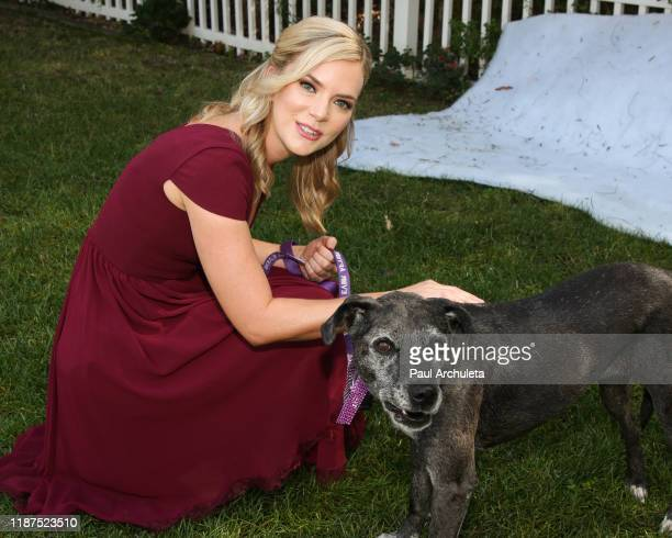 Actress Cindy Busby poses with a rescue dog at Hallmark Channel's Home Family at Universal Studios Hollywood on November 13 2019 in Universal City...