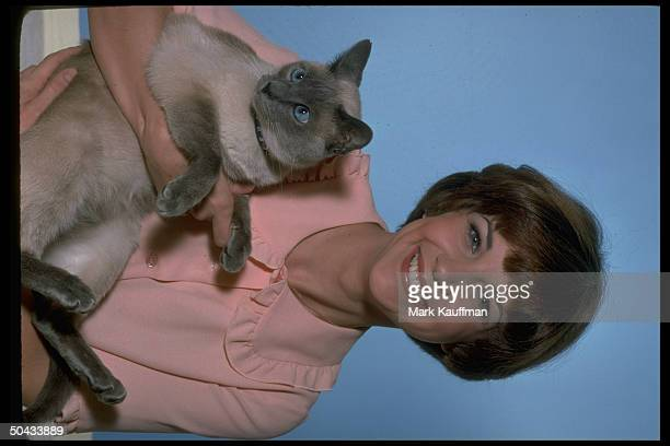 Actress Cindy Williams holding Siamese cat