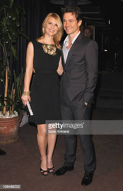 Actress Claire Danes and Hugh Dancy arrive at the Chanel Charles Finch PreOscar Dinner Celebrating Fashion Film at Madeo Restaurant on February 26...