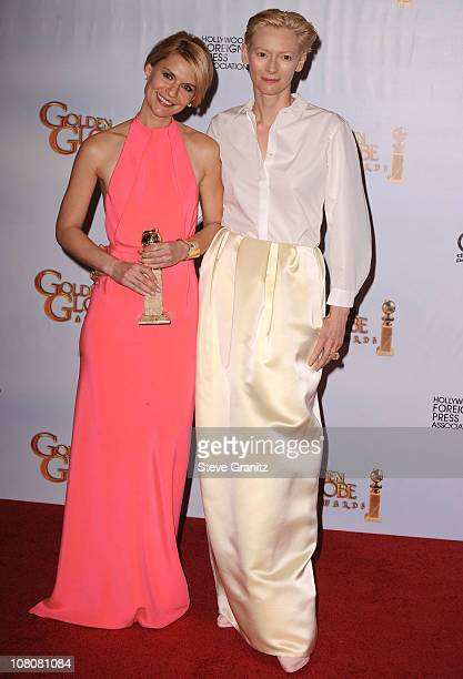 Actress Claire Danes and Tilda Swinton pose in the press room at the 68th Annual Golden Globe Awards held at The Beverly Hilton hotel on January 16,...
