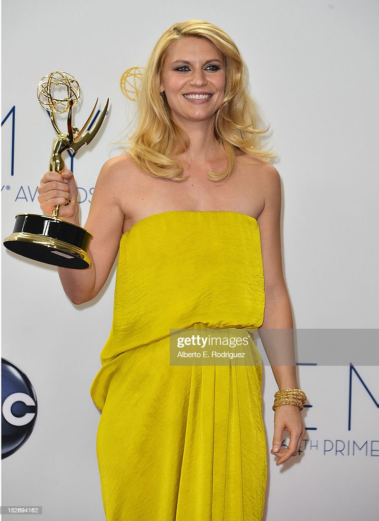 Actress Claire Danes poses in the 64th Annual Emmy Awards press room at Nokia Theatre L.A. Live on September 23, 2012 in Los Angeles, California.