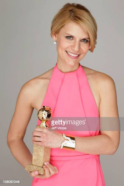 Actress Claire Danes poses with her award for Best Performance by an Actress in a MiniSeries or Motion Picture Made for Television for Temple Grandin...