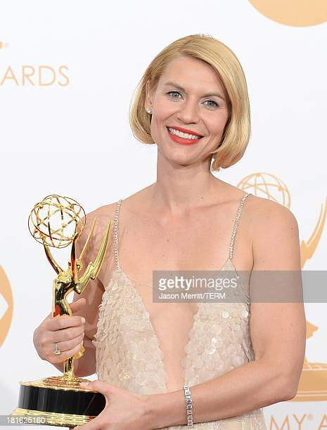 Actress Claire Danes winner of the Best Actress In a Drama Series for Homeland poses in the press room during the 65th Annual Primetime Emmy Awards...