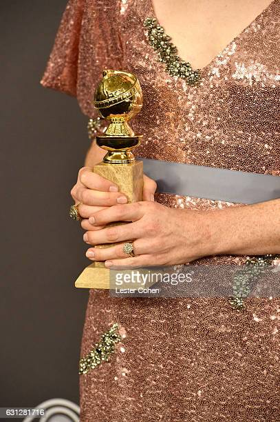 Actress Claire Foy Golden Globe trophy detail attends the 18th Annual PostGolden Globes Party hosted by Warner Bros Pictures and InStyle at The...