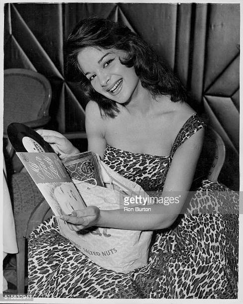 Actress Claire Gordon holding her gift parcel at the Variety Club of Great Britain Luncheon Dorchester Hotel London June 10th 1958
