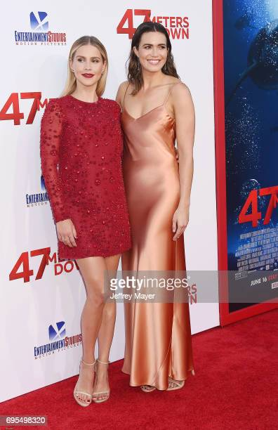 Actress Claire Holt and actresssinger Mandy Moore attend the Premiere Of Dimension Films' '47 Meters Down' at Regency Village Theatre on June 12 2017...
