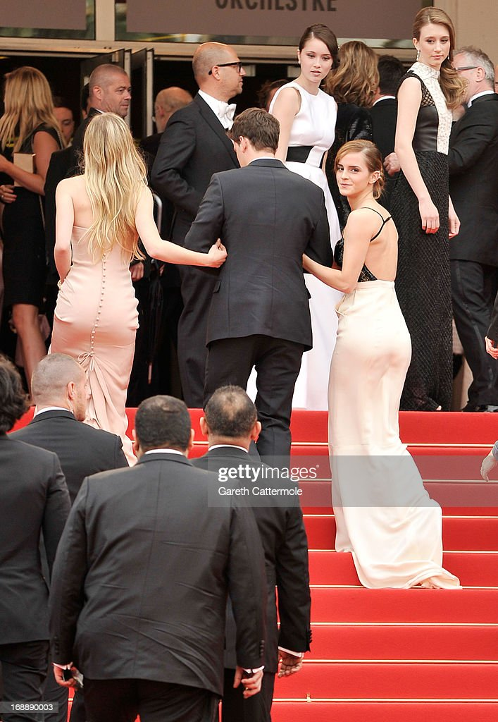 Actress Claire Julien, actor Israel Broussard and actress Emma Watson walk behind actresses Taissa Fariga (R) and Katie Chang (C) during 'The Bling Ring' premiere during The 66th Annual Cannes Film Festival at the Palais des Festivals on May 16, 2013 in Cannes, France.