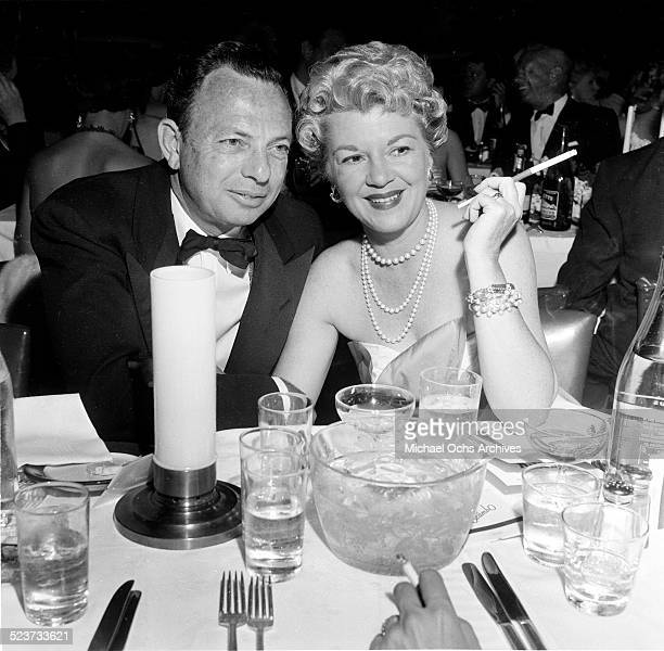 Actress Claire Trevor and and husband Milton H Bren attend the movie premiere party of High and Mighty in Los AngelesCA