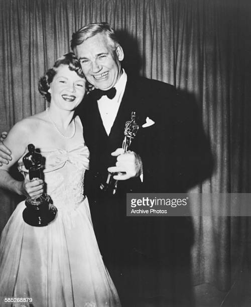 Actress Claire Trevor holding her Best Supporting Actress Oscar for the film 'Key Largo' with John Huston holding his Best Supporting Actor Oscar for...