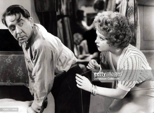 Actress Clara Bow and Herbert Mundin in a scene from the movie HoopLa