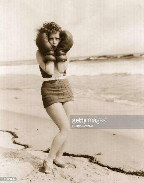 Actress Clara Bow the 'It' girl poses on Malibu beach in boxing gloves