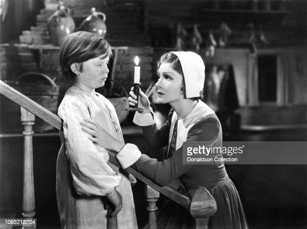 Actress Claudette Colbert and Benny Bartlett in a scene from the movie 'Maid of Salem'