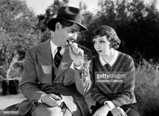 "Actress Claudette Colbert and Clark Gable in a scene from the movie ""It Happened One Night"""