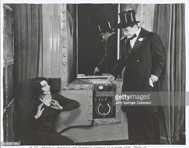 Actress Claudette Colbert as Jean Oliver and actor Edward G Robinson as The Fox in the 1929 film The Hole in the Wall