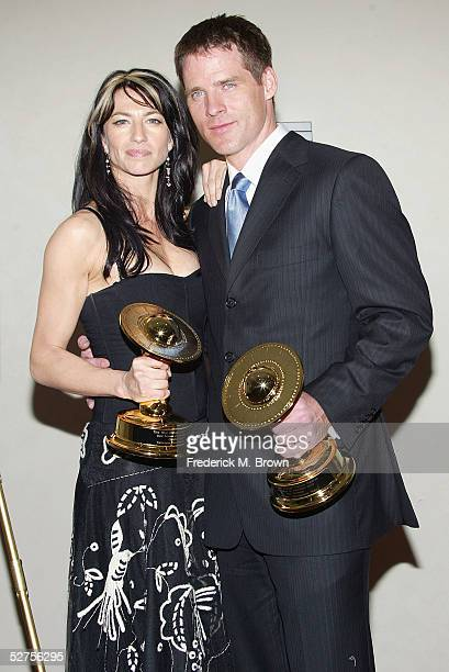 Actress Claudia Black poses with her award for Best Actress alongside actor Ben Browder who was honored for Best Actor during the 31st Annual Saturn...
