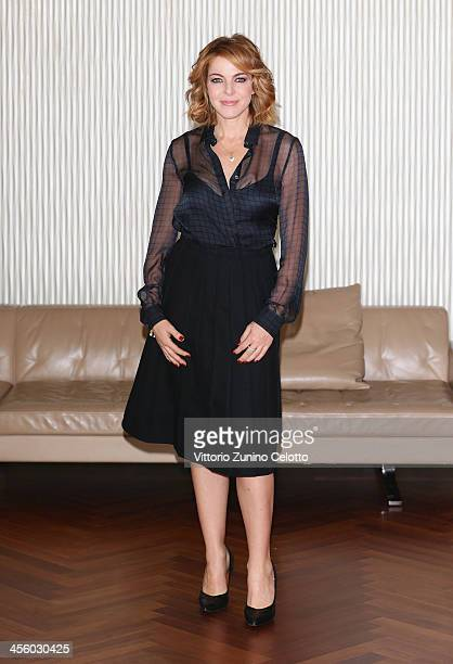 Actress Claudia Gerini attends 'Indovina Chi Viene A Natale' photocall on December 13 2013 in Milan Italy