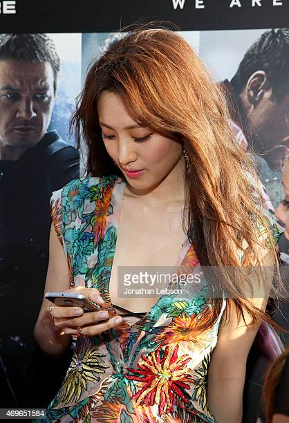 Actress Claudia Kim takes a selfie using the new Samsung Galaxy S 6 edge at the release of Avengers Age Of Ultron at Dolby Theatre on April 13 2015...