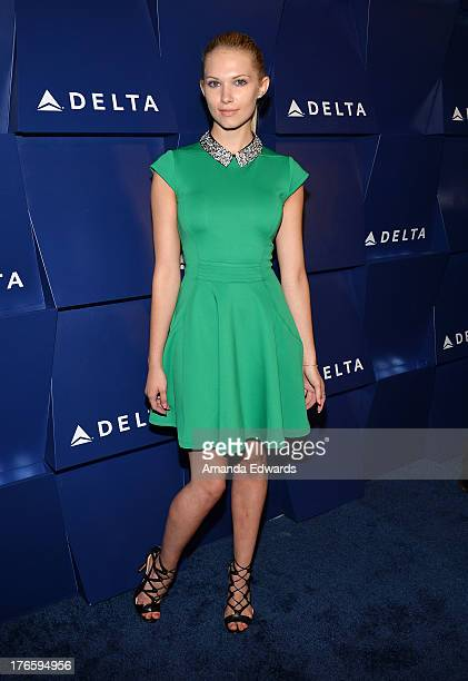 Actress Claudia Lee arrives at the Delta Air Lines Summer Celebration at Beverly Grove Drive on August 15 2013 in Beverly Hills California