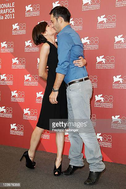 Actress Claudia Pandolfi and actor Filippo Timi pose at the Quando La Notte photocall during the 68th Venice Film Festival at Palazzo del Cinema on...