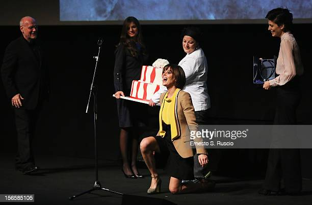 Actress Claudia Pandolfi falls on stage during the Collateral Awards Ceremony at the 7th Rome Film Festival at the Auditorium Parco Della Musica on...