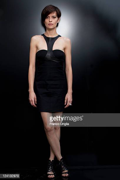 Actress Claudia Pandolfi poses during the Quando La Notte portrait session at the Lancia Cafe during the 68th Venice Film Festival on September 8...