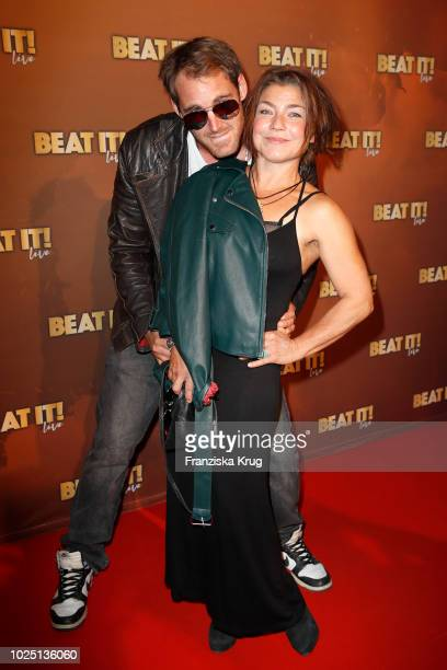 Actress Claudia Schmutzler and Soenke Schnitzer attend the musical premiere of 'BEAT IT Die Show ueber den King of Pop' at Stage Theater on August 29...