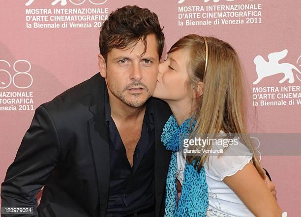 Actress Claudia Vega kisses director KikeMaillo the Eva Photocall during the 68th Venice International Film Festival at Palazzo del Casino on...