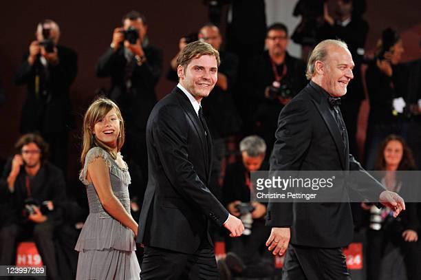 Actress Claudia Vega with actors Daniel BruhlLluis Homar attend the Eva premiere during the 68th Venice Film Festival at Palazzo del Cinema on...