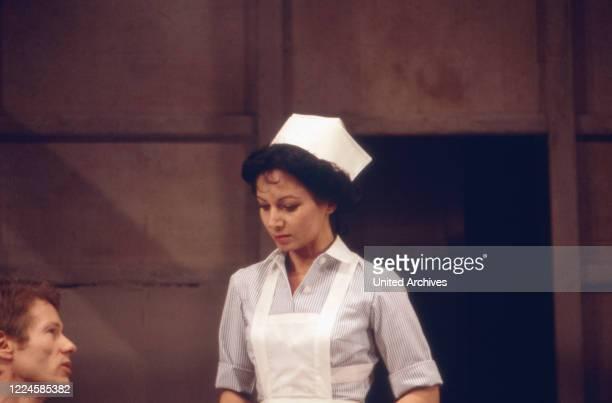Actress Claudia Wedekind as a nurse, Germany, 1970s.