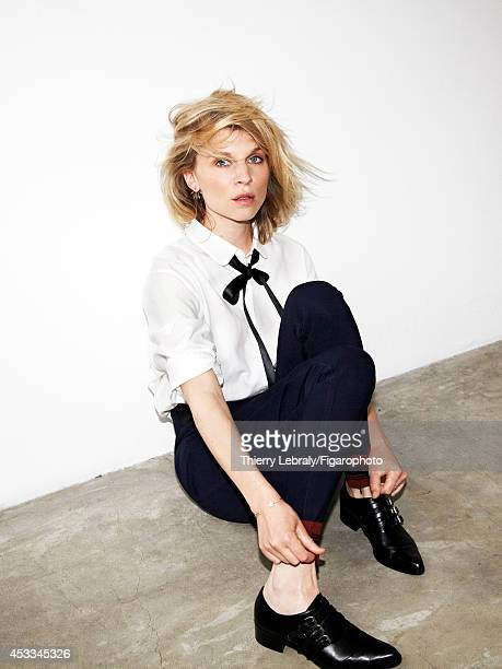 110170003 Actress Clemence Poesy is photographed for Madame Figaro on June 1 2014 in Paris France Shirt pants earrings rings and bracelet ribbon...