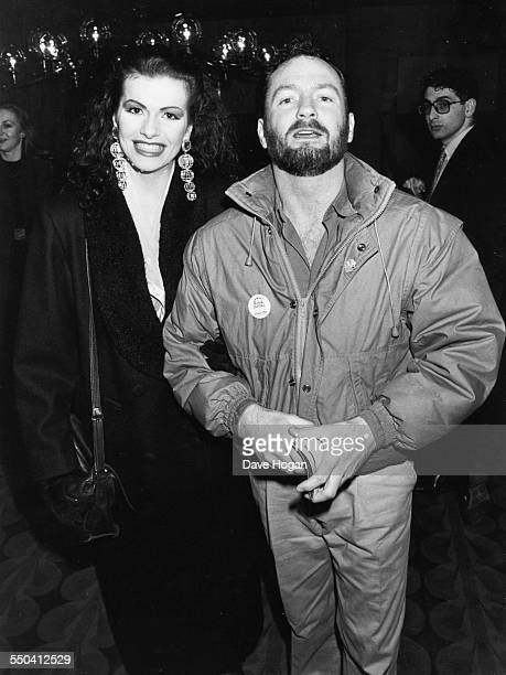 Actress Cleo Rocos and comedy entertainer Kenny Everett at the premiere of the film 'Die Hard' 1988