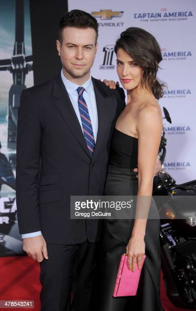 Actress Cobie Smulders and husband Taran Killam arrive at the Los Angeles premiere of 'Captain America The Winter Soldier' at the El Capitan Theatre...