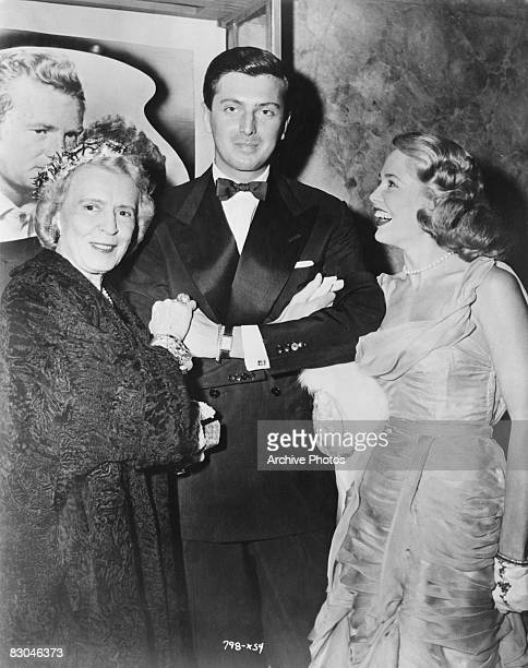 Actress Cobina Wright French fashion designer Hubert de Givenchy and American actress Sara Shane pose together at the premiere of the film 'So Big'...