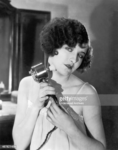 Actress Colleen Moore using a StarRite Electric Massage Vibrator Hollywood California mid to late 1920s