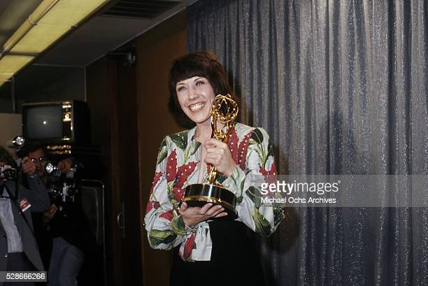 Actress, comedian, writer and producer holds up her Emmy Award for her special 'lily' at the 26th Emmy Awards held at the Pantages Theatre on May 28,...