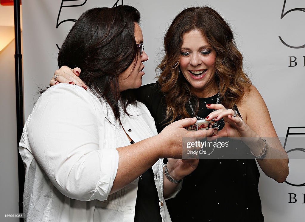 Actress/ comedianRosie O'Donnell shares photos of her children with actress/ singer Rita Wilson backstage following her performance at 54 Below on April 18, 2013 in New York City.