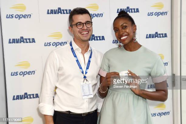 Actress Condola Rashad enjoys coffee with President and CEO of Lavazza America Davide Riboni in the Lavazza Lounge during the 2019 US Open at Arthur...