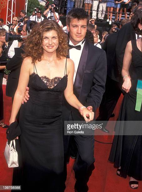 Actress Connie Britton and actor Nathan Fillion on September 14 1997 at the Pasadena Civic Auditorium in Pasadena California