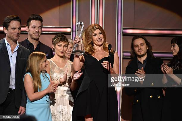 Actress Connie Britton and the cast of ABC's Nashville receive award onstage during the 2015 'CMT Artists of the Year' at Schermerhorn Symphony...