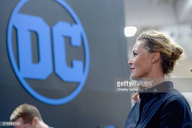 Actress Connie Nielsen from the 2017 feature film Wonder Woman signs autographs for fans in DC's 2016 San Diego ComicCon booth at San Diego...